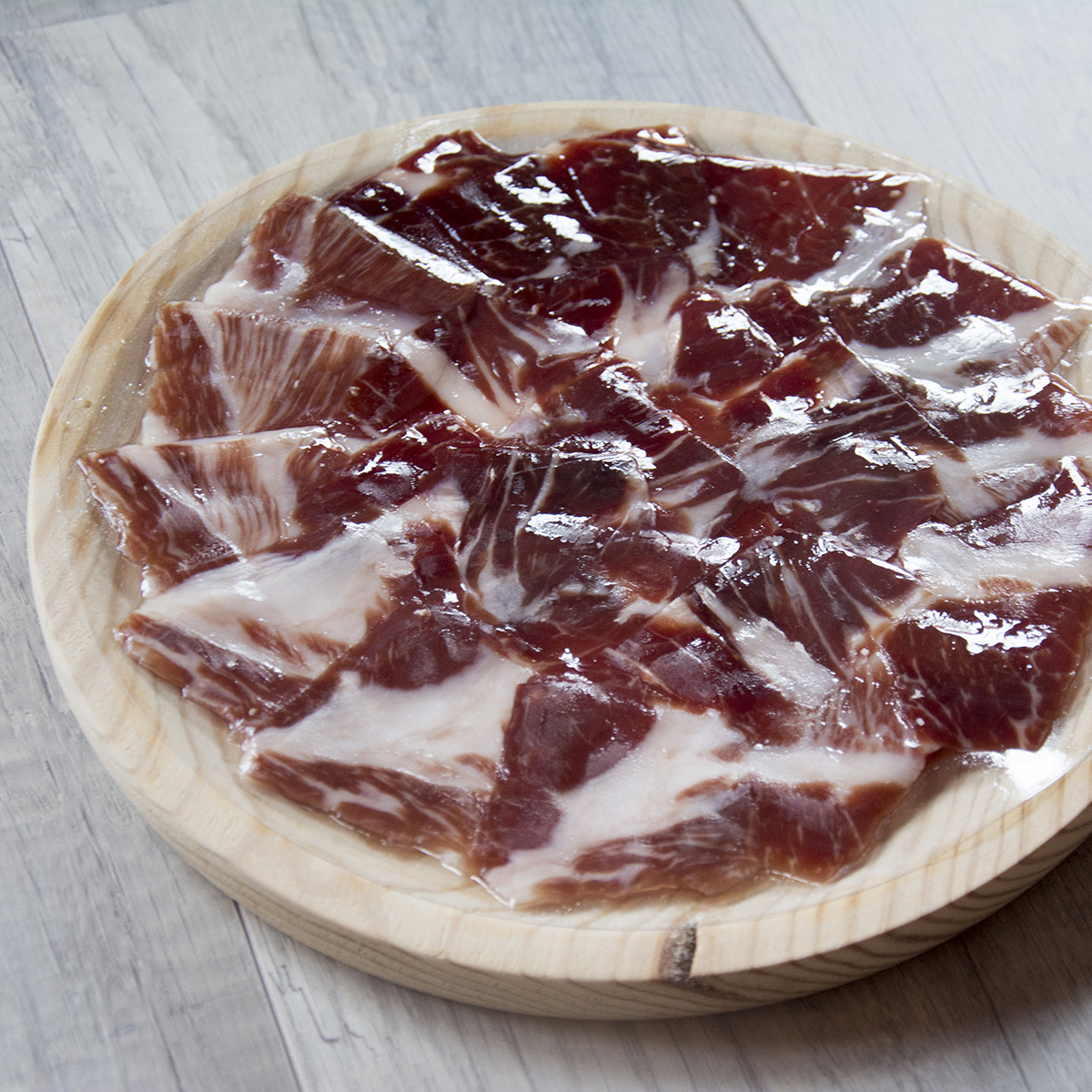 Fodder-Fed Iberian Ham cut with knife
